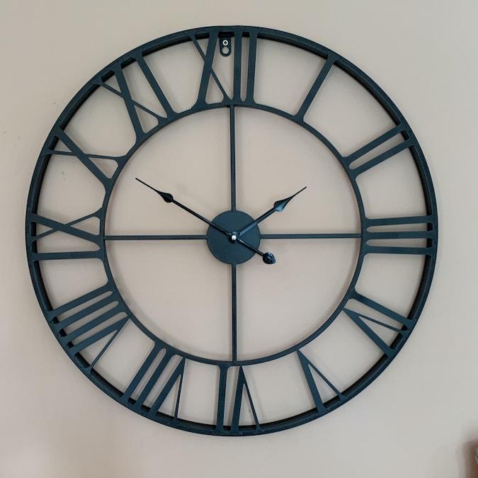 Aged metal clock